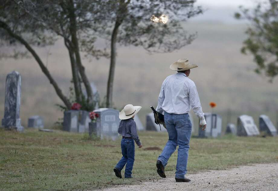 Mourners enter the Sutherland Springs Cemetery during the funeral of Sutherland Springs shooting victims Therese and Ricardo Rodriguez Saturday, Nov. 11, 2017. Photo: Edward A. Ornelas /San Antonio Express-News / © 2017 San Antonio Express-News