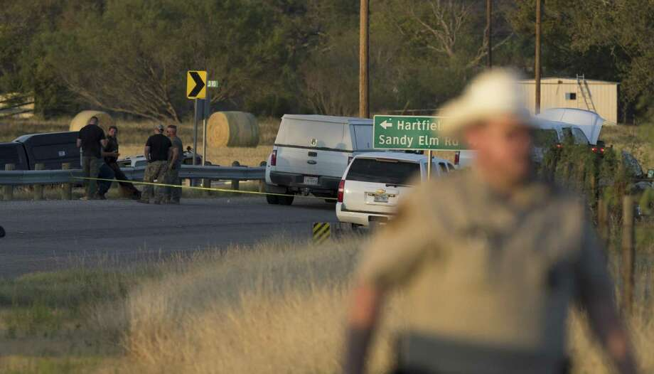 Investigators secure the scene near the intersection of FM 539 and Sandy Elm Road in Guadalupe County where Devin Kelley crashed and committed suicide. (William Luther | San Antonio Express-News) / © 2017 San Antonio Express-News