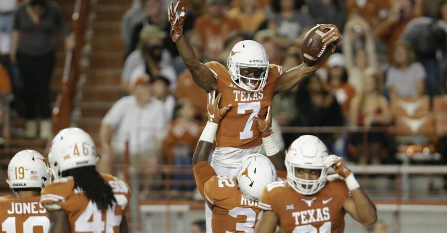 AUSTIN, TX - NOVEMBER 11:  Malcolm Roach #32 of the Texas Longhorns lifts Antwuan Davis #7 in celebration after an interception in the second quarter at Darrell K Royal-Texas Memorial Stadium on November 11, 2017 in Austin, Texas.  (Photo by Tim Warner/Getty Images) Photo: Tim Warner/Getty Images