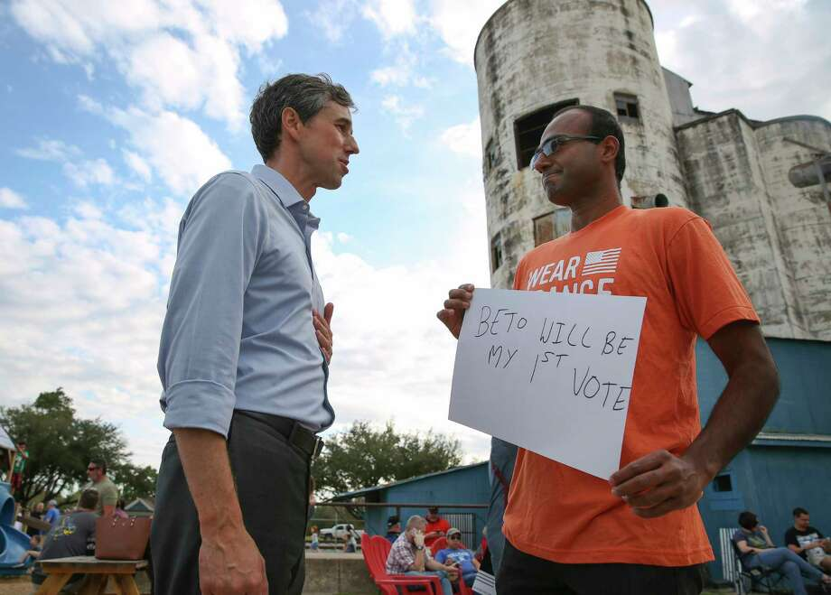 U.S. Congressman Beto O'Rourke, who is challenging U.S. Sen. Ted Cruz's seat in the next election, talks to Arvind Sriraman at a rally at No Label Brewery  Saturday, Nov. 11, 2017, in Katy. Sriraman, a member of Moms Demand Action for Gun Sense in America, is from India and could become a U.S. citizen in July, 2018. Sriraman said he is determined to vote for O'Rourke because he lost his wife in a gun violence five years ago and O'Rourke supports gun sense. ( Yi-Chin Lee / Houston Chronicle ) Photo: Yi-Chin Lee, Staff / © 2017 Houston Chronicle