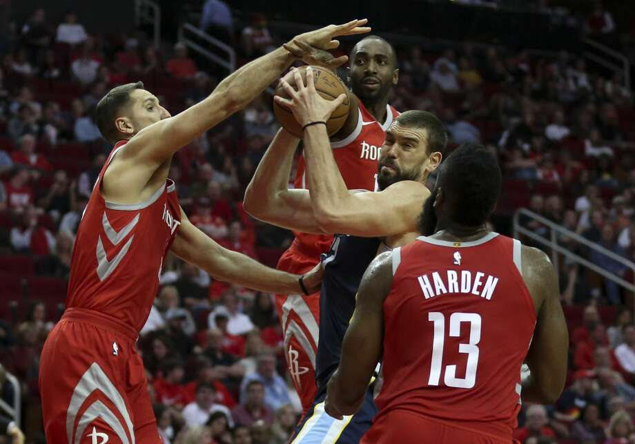 Houston Rockets players Ryan Anderson (33), Luc Mbah a Moute (12) and James Harden (13) defensing Memphis Grizzlies center Marc Gasol (33) under the basket during the third quarter of an NBA game at Toyota Center on Saturday, Nov. 11, 2017, in Houston. The Houston Rockets defeated the Memphis Grizzlies 111-99. ( Yi-Chin Lee / Houston Chronicle ) Photo: Yi-Chin Lee/Houston Chronicle