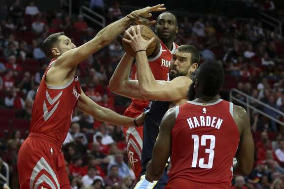 Houston Rockets players Ryan Anderson (33), Luc Mbah a Moute (12) and James Harden (13) defensing Memphis Grizzlies center Marc Gasol (33) under the basket during the third quarter of an NBA game at Toyota Center on Saturday, Nov. 11, 2017, in Houston. The Houston Rockets defeated the Memphis Grizzlies 111-99. ( Yi-Chin Lee / Houston Chronicle )