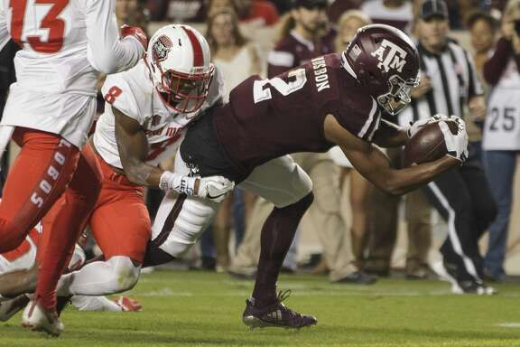 Texas A&M wide receiver Jhamon Ausbon (2) lunges for the goal line for a touchdown as New Mexico defensive back Willie Hobdy (8) defends during the first quarter of an NCAA college football game on Saturday, Nov. 11, 2017, in College Station, Texas. (AP Photo/Sam Craft)