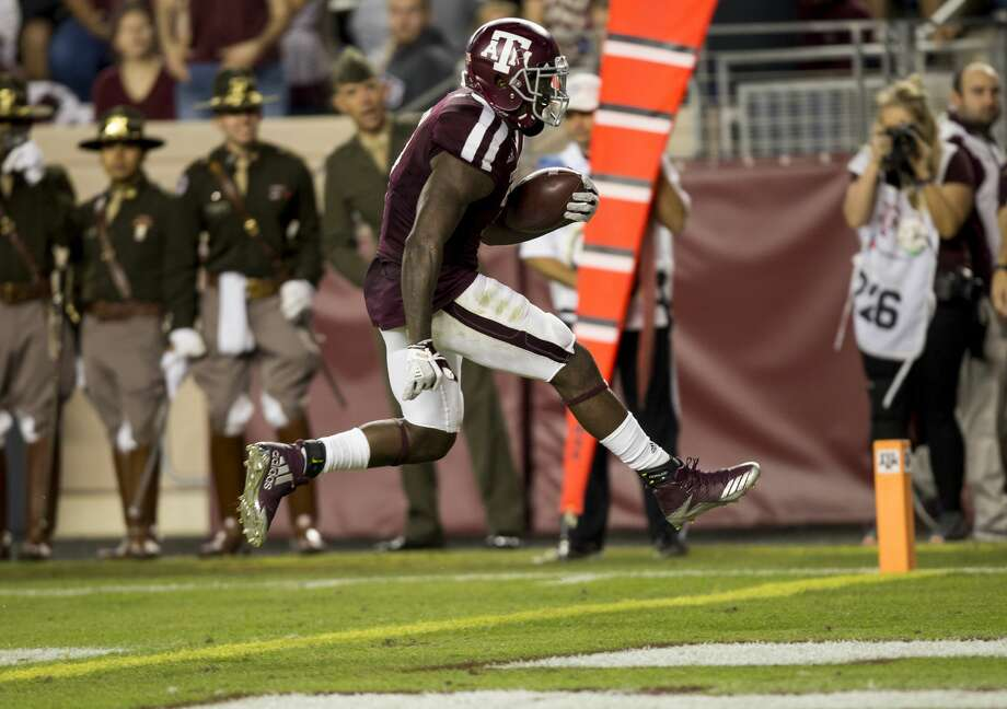 Texas A&M running back Keith Ford (7) skips over the goal line for a touchdown after a 12 yard run against New Mexico during the second quarter of an NCAA college football game on Saturday, Nov. 11, 2017, in College Station, Texas. (AP Photo/Sam Craft) Photo: Sam Craft/Associated Press