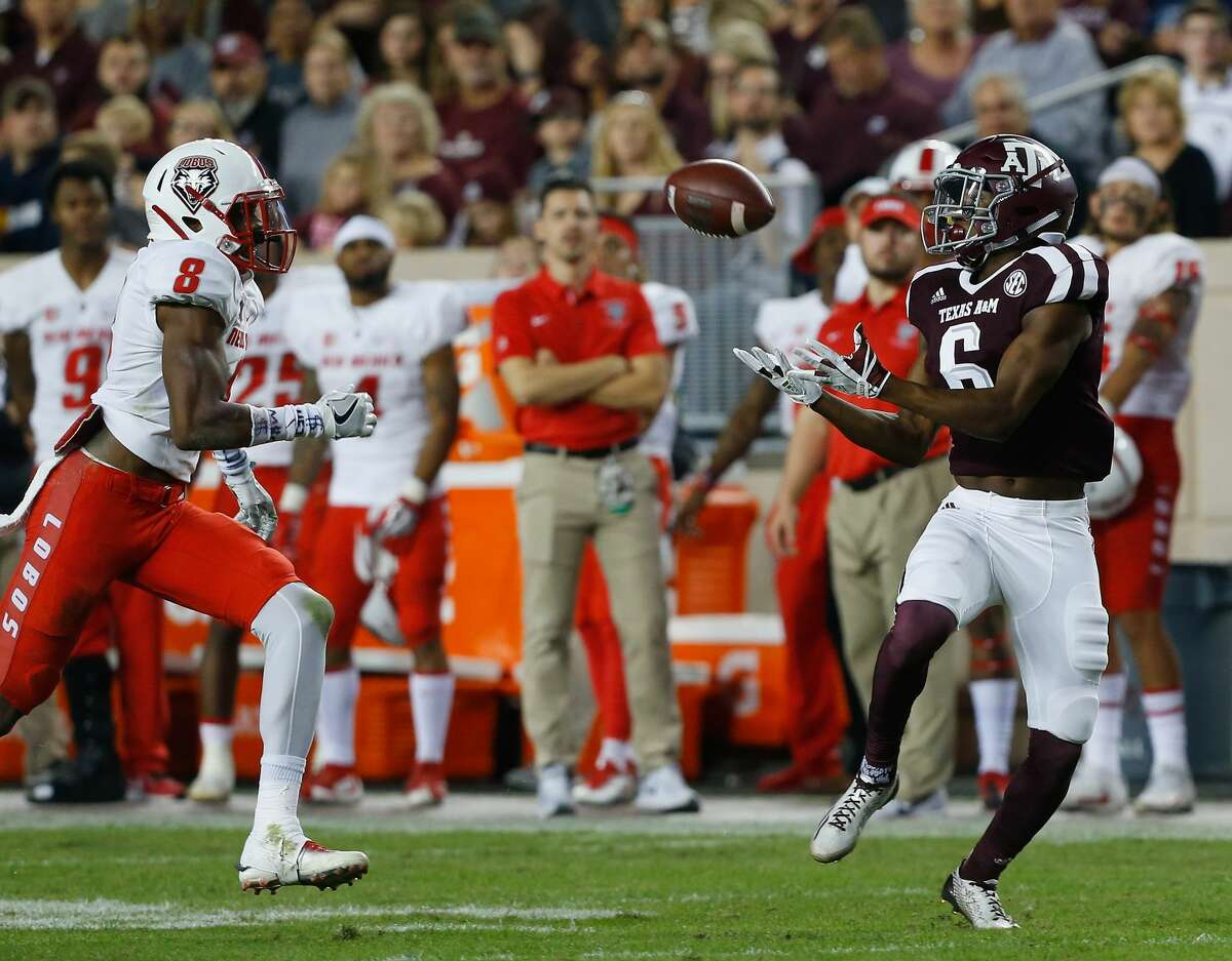 COLLEGE STATION, TX - NOVEMBER 11: Roshauud Paul #6 of the Texas A&M Aggies makes a catch as he slips behind Willie Hobdy #8 of the New Mexico Lobos at Kyle Field on November 11, 2017 in College Station, Texas. (Photo by Bob Levey/Getty Images)