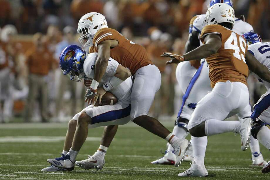 AUSTIN, TX - NOVEMBER 11:  Jason Hall #31 of the Texas Longhorns sacks Carter Stanley #9 of the Kansas Jayhawks in the fourth quarter at Darrell K Royal-Texas Memorial Stadium on November 11, 2017 in Austin, Texas.  (Photo by Tim Warner/Getty Images) Photo: Tim Warner, Stringer / Getty Images / 2017 Getty Images