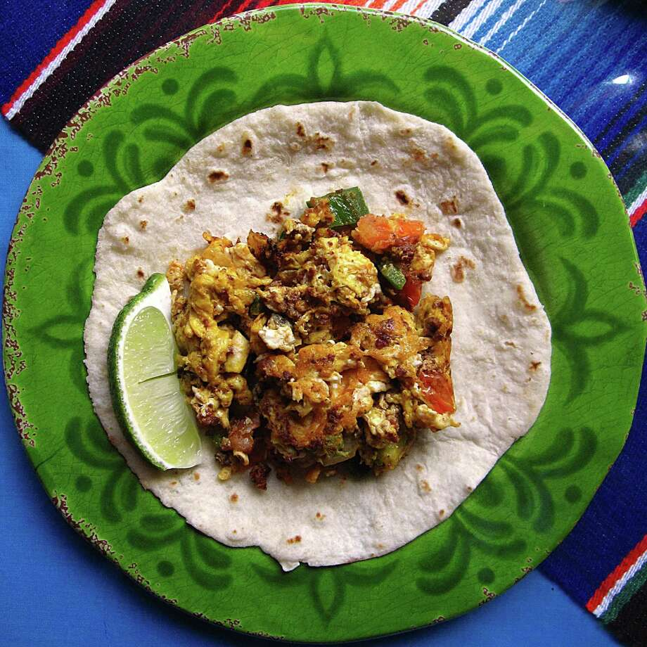 Chorizo and egg a la mexicana taco on a handmade flour tortilla from Oasis Mexican Cafe. Photo: Mike Sutter /San Antonio Express-News