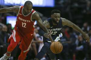 Houston Rockets forward Luc Mbah a Moute (12) and Memphis Grizzlies guard Tyreke Evans (12) battle for a loose ball during the fourth quarter of an NBA game at Toyota Center on Saturday, Nov. 11, 2017, in Houston. ( Yi-Chin Lee / Houston Chronicle )
