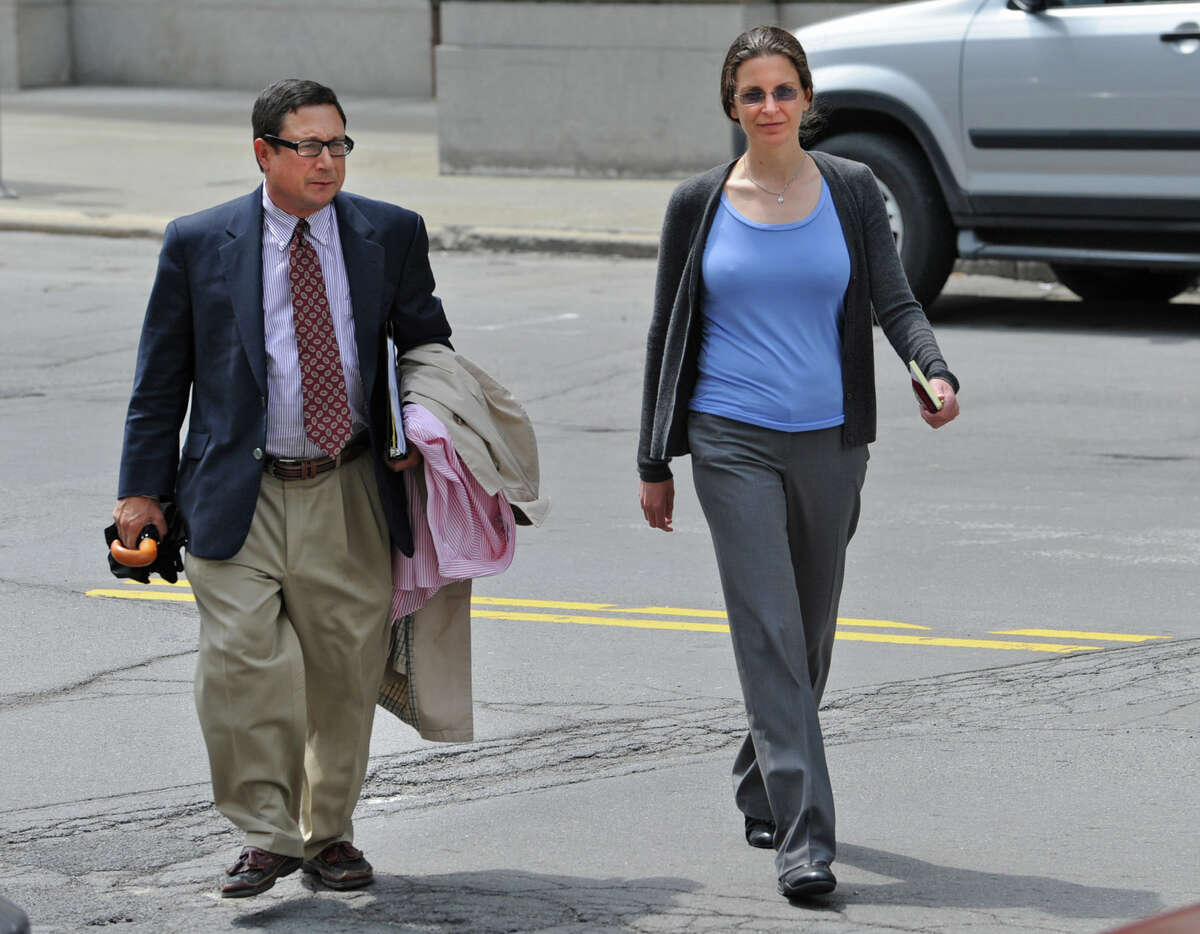 Attorney William Savino and Clare Bronfman walk into the Federal Courthouse on Broadway in Albany, N.Y. on Tuesday May 3, 2011. (Lori Van Buren/Times Union archive)