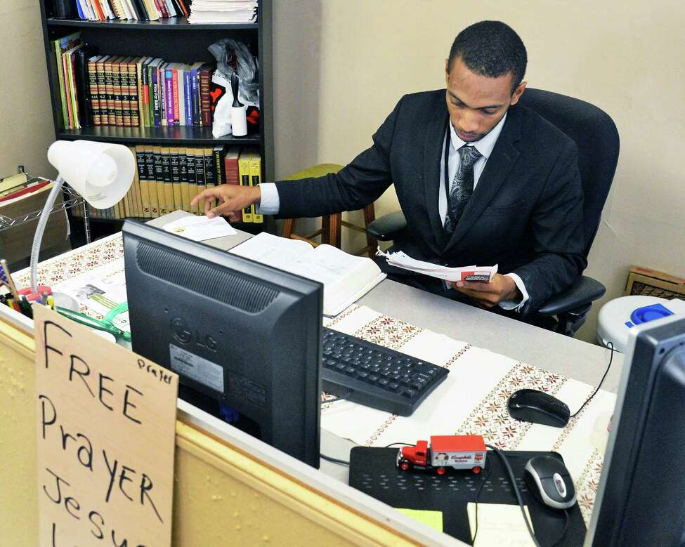 Pastor and school social worker Erasto Nova in his office at the Iglesia Pentecostal Unidad y Oraci?-n church Wednesday Nov. 8, 2017 in Albany, NY. (John Carl D'Annibale / Times Union)