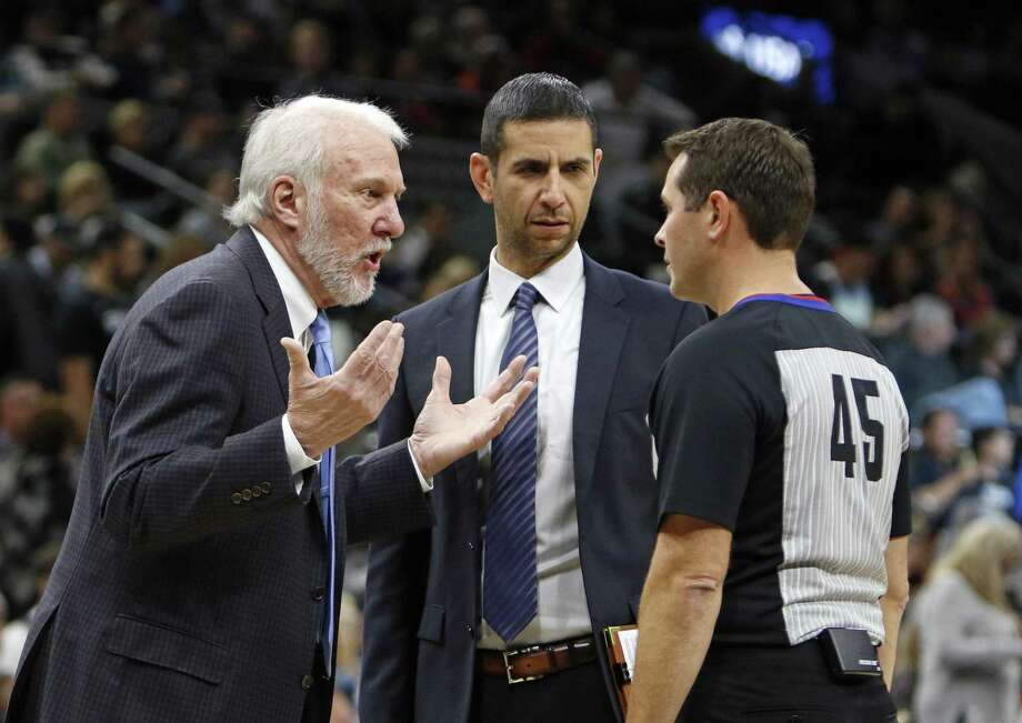 San Antonio Spurs head coach Gregg Popovich argues with official Brian Forte as asst. coach James Borrego listens,C,during NBA game between San Antonio Spurs  Chicago Bulls on Saturday, November 11, 2017. Photo: Ron Cortes, Freelance / For The San Antonio Express-News