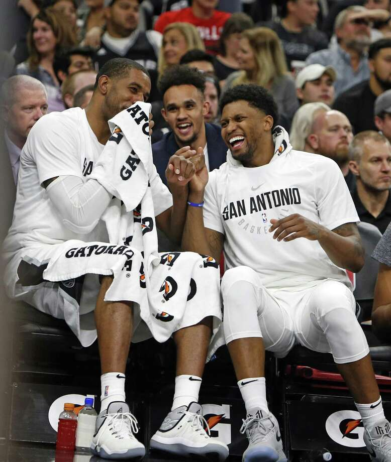LaMarcus Aldridge #12 of the San Antonio Spurs,L, and Rudy Gay #22 of the San Antonio Spurs enjoy a light moment on the bench during the fourth quarter in a NBA game between San Antonio Spurs  Chicago Bulls on Saturday, November 11, 2017. Photo: Ron Cortes, Freelance / For The San Antonio Express-News