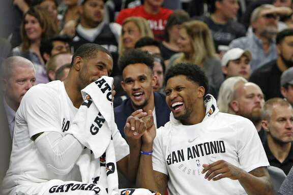LaMarcus Aldridge #12 of the San Antonio Spurs,L, and Rudy Gay #22 of the San Antonio Spurs enjoy a light moment on the bench during the fourth quarter in a NBA game between San Antonio Spurs  Chicago Bulls on Saturday, November 11, 2017.