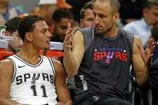 Manu Ginobili #20 of the San Antonio Spurs,R, talks with Bryn Forbes #11 of the San Antonio Spurs during NBA game between San Antonio Spurs  Chicago Bulls on Saturday, November 11, 2017.