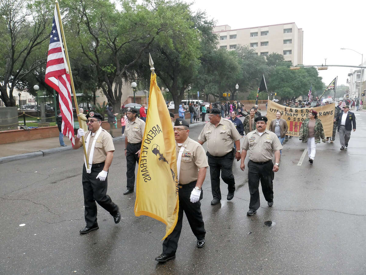 Representatives of the Laredo Veterans Color Guard lead the marching veterans at the annual Veterans Day Parade, Saturday, November 11, 2017.