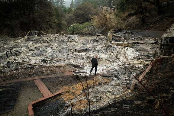 Dan Nielson surveys the remains of his home in Santa Rosa on Friday, November 3, 2017. Mr. Nielson's home was leveled by the Tubbs fire which destroyed more than 5,100 structures in Northern California.