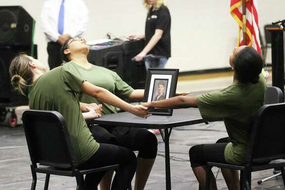 Members of the Liberty High School Color Guard perform a contemporary dance depicting the pain of war and their missing loved one.