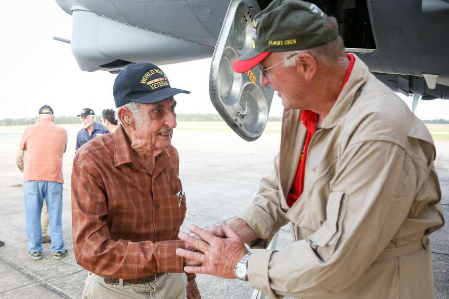 World War II veteran James Bivin, 96, left, shakes hands with Per Barsten, of the Texas Raiders, right, exits a B-17 Flying Fortress after going on a flight Saturday, Nov. 12, 2017, at Conroe-North Houston Regional Airport. Photo: Michael Minasi/Houston Chronicle