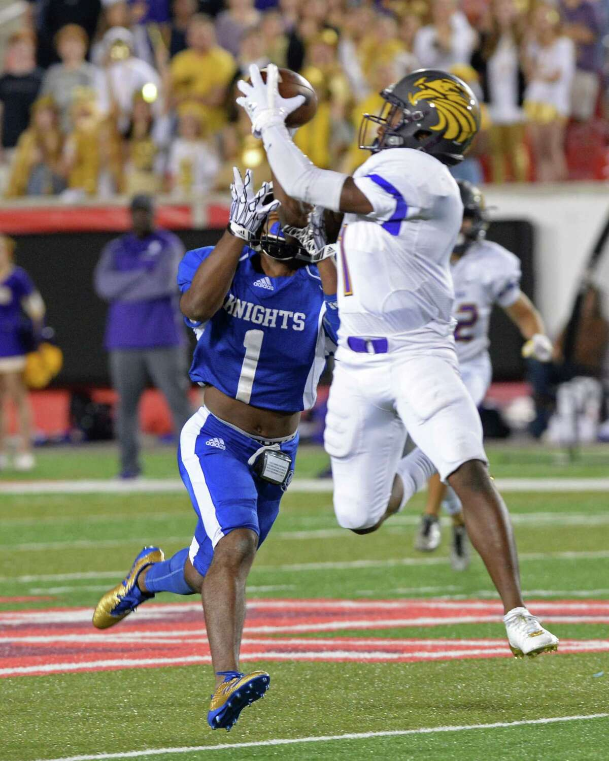 Johnathon Thomas (1) of Kinkaid intercepts a pass intended for Jaylen Davis (1) of Episcopal in the first quarter of SPC Football Championship game between the Kinkaid Falcons and the Episcopal Knights on November 11, 2017 at TDECU Stadium, Houston, TX.