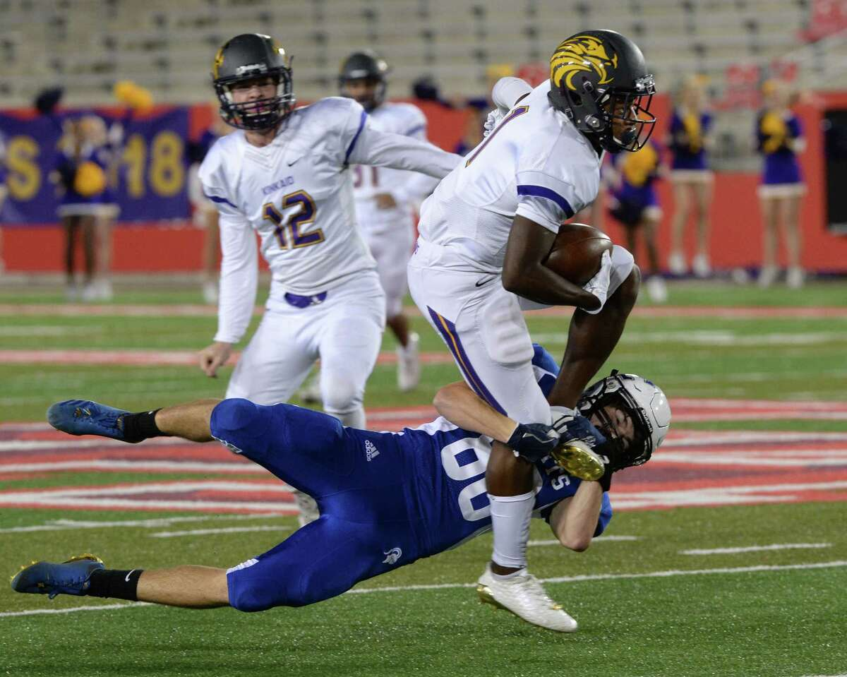 Avery Edwards (80) of Episcopal tries to stop Johnathon Thomas (1) of Kinkaid after he intercepted a pass in the first quarter of SPC Football Championship game between the Kinkaid Falcons and the Episcopal Knights on November 11, 2017 at TDECU Stadium, Houston, TX.