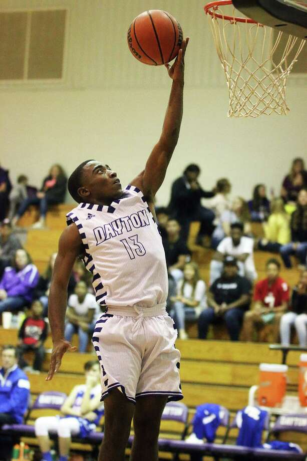 Keyth Williams drops in a basket for the Broncos in their blowout win over First Baptist Church, Pasadena last Saturday at home, 83-17. Williams earned 15 points on the night. Photo: David Taylor