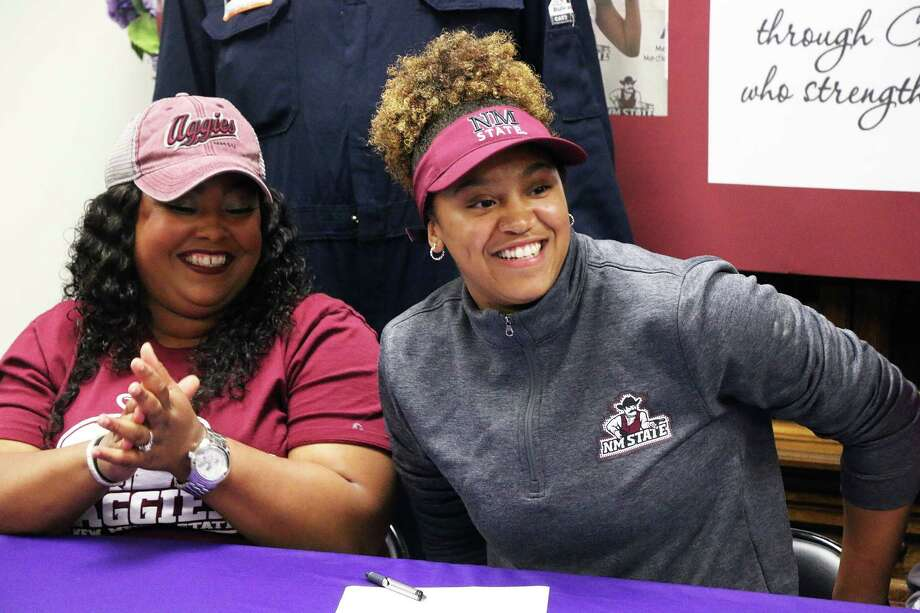 Tayelin Grays and her mother Toye Dugat were all smiles on Wednesday as Grays signed a National Letter of Intent to play basketball for New Mexico State University. Grays will receive a full-ride scholarship. Photo: David Taylor
