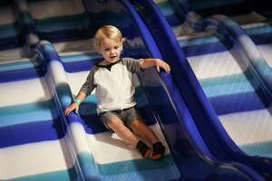 Barrett Dyson, 2, flies down a slide on Monday, Nov. 6, 2017, at Kanga's Indoor Playcenter in The Woodlands.