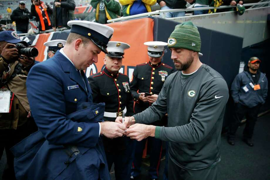 Green Bay Packers  Aaron Rodgers signs autographs for the members of the  U.S. Coast Guard a41ad0042