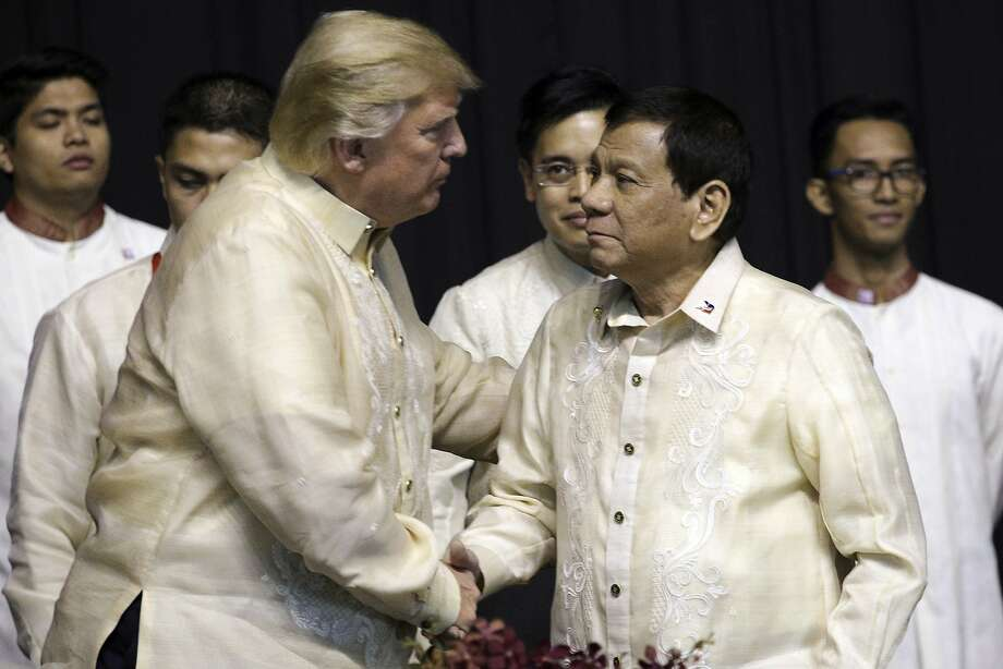 President Trump greets Philippine President Rodrigo Duterte during a gala dinner ahead of an annual summit of Southeast Asian nations taking place this year in Manila. Photo: Athit Perawongmetha, Associated Press
