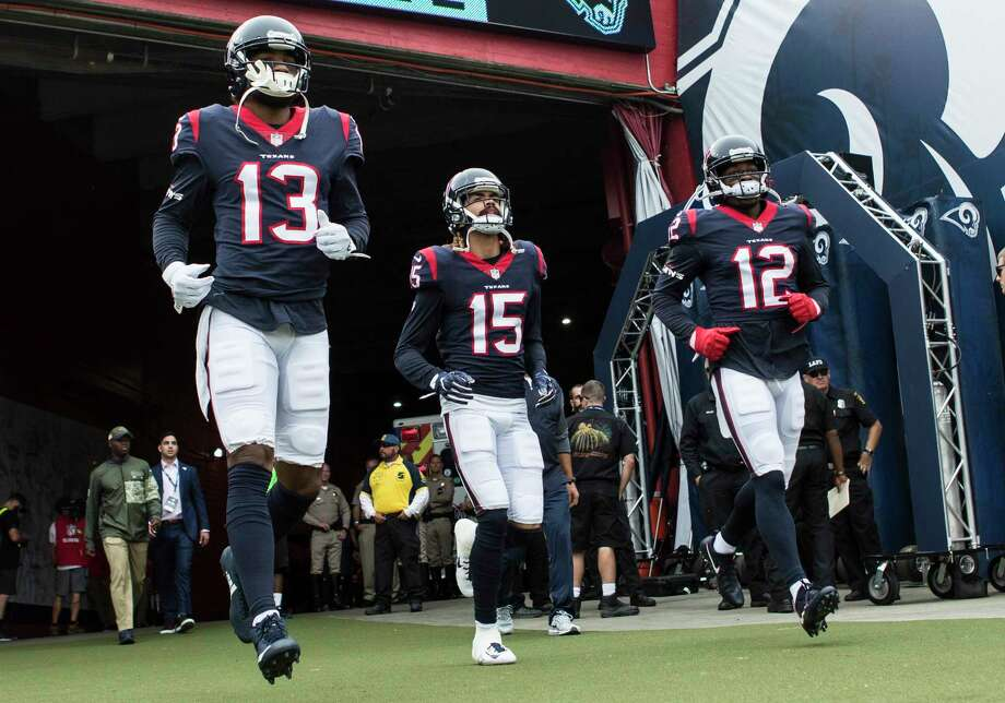 Houston Texans wide receivers Braxton Miller (13), Will Fuller (15) and Bruce Ellington (12) run onto the field before an NFL football game against the Los Angeles Rams at the Los Angeles Memorial Coliseum on Sunday, Nov. 12, 2017, in Los Angeles. Photo: Brett Coomer, Houston Chronicle / © 2017 Houston Chronicle