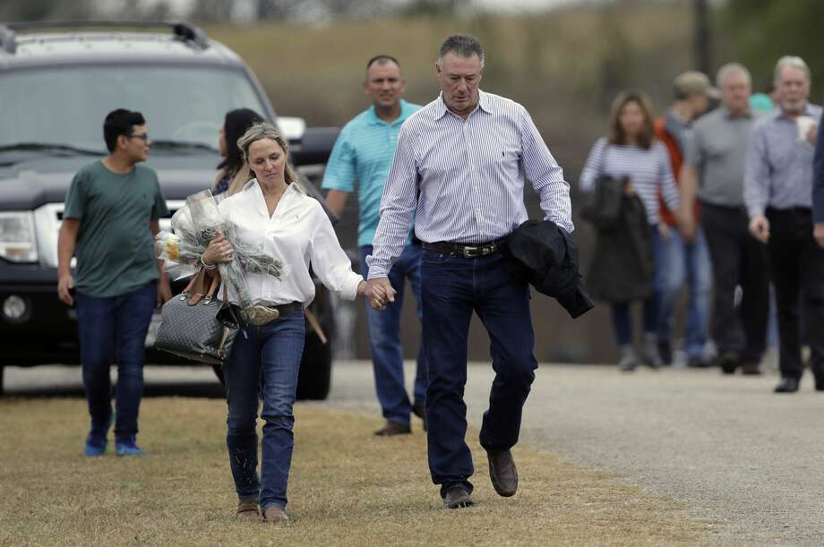 Mourners leaves a worship service for the victims of the shooting at Sutherland Springs Baptist Church, Sunday, Nov. 12, 2017, in Sutherland Springs, Texas, after a man opened fire inside the church last Sunday. Church members will gather this week in a large tent set up at a baseball park. (AP Photo/Eric Gay) Photo: Eric Gay/Associated Press