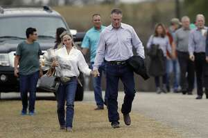 Mourners leaves a worship service for the victims of the shooting at Sutherland Springs Baptist Church, Sunday, Nov. 12, 2017, in Sutherland Springs, Texas, after a man opened fire inside the church last Sunday. Church members will gather this week in a large tent set up at a baseball park. (AP Photo/Eric Gay)