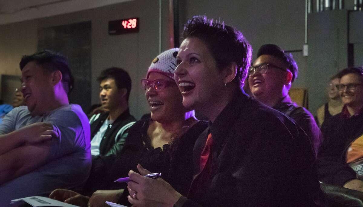 The judges - poet/visual artist Truong Tran (left), writer Faith Adiele and novelist Carolina De Robertis - find de Vergas' story amusing.