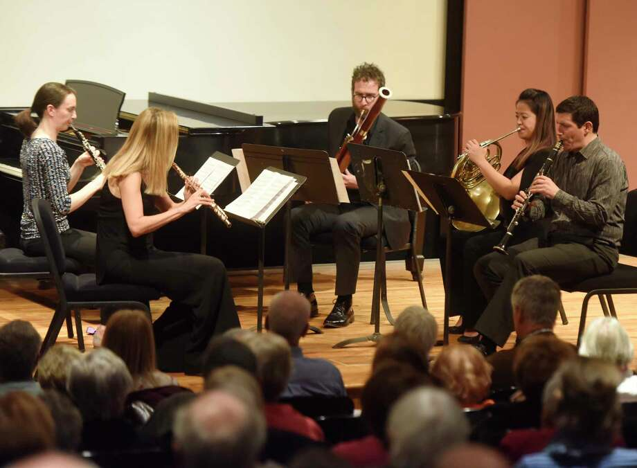 From left, Mary Lynch, oboe, Marina Piccinini, flute, Brad Balliett, bassoon, Wei-Ping Chou, horn, Michael Rusinek, clarinet, perform as the Musicians from Marlboro as part of the free Friends Cole Concert Series at Greenwich's Library's Cole Auditorium in Greenwich, Conn. Sunday, Nov. 12, 2017. The Musicians from Marlboro group rotates talented young professional musicians with seasoned veteran artists in varied chamber music programs. Photo: Tyler Sizemore, Hearst Connecticut Media / Greenwich Time