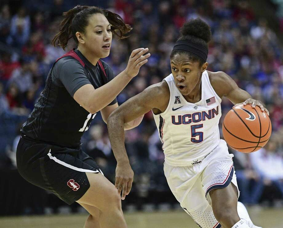 UConn's Crystal Dangerfield drives on Stanford's Marta Sniezek during the first quarter Sunday in Columbus, Ohio. Photo: David Dermer / Associated Press / AP 2017