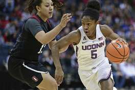 UConn's Crystal Dangerfield drives on Stanford's Marta Sniezek during the first quarter Sunday in Columbus, Ohio.