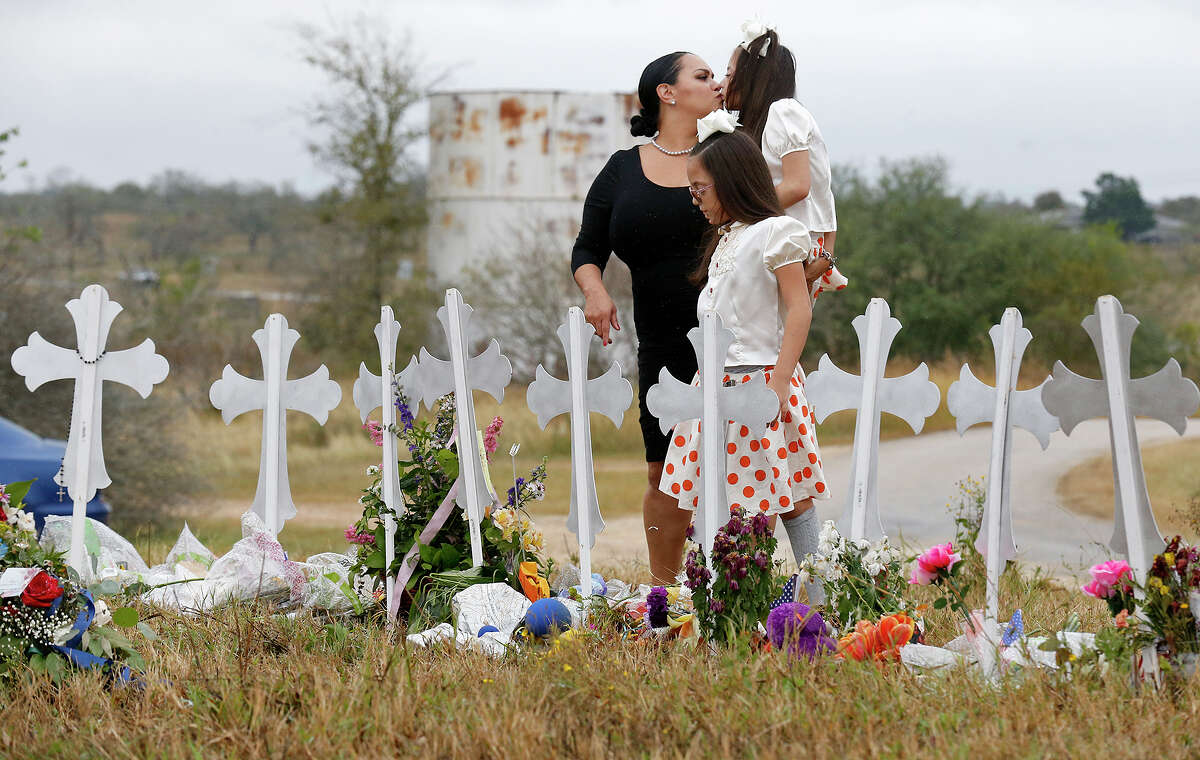 Meredith Cooper and her daughters Heather and Holly Cooper visit the 26 crosses, Sunday Nov. 12, 2017, for those killed in the mass shooting at the First Baptist Church of Sutherland Springs. Edward A. Ornelas/San Antonio Express-News