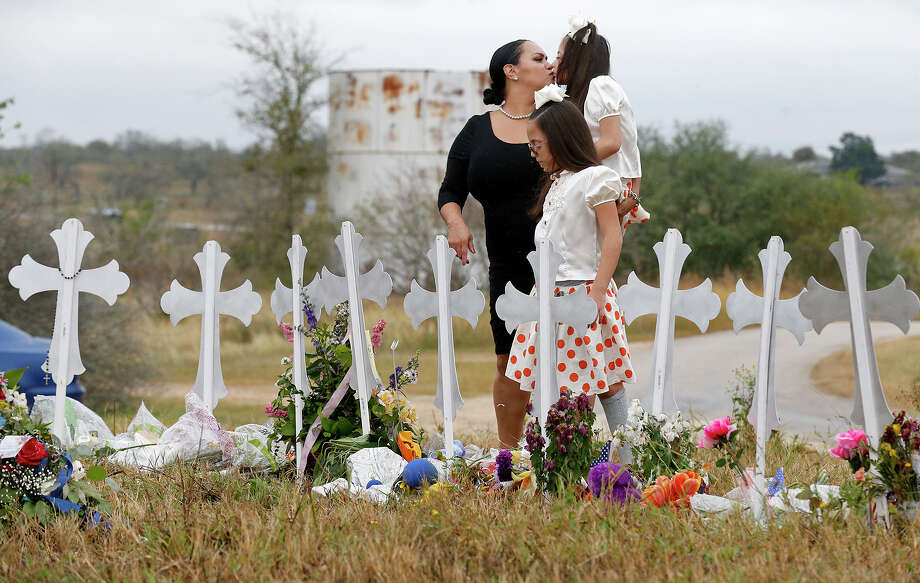 Meredith Cooper and her daughters Heather and Holly Cooper visit the 26 crosses, Sunday Nov. 12, 2017, for those killed in the mass shooting at the First Baptist Church of Sutherland Springs. Edward A. Ornelas/San Antonio Express-News Photo: Edward A. Ornelas/San Antonio Express-News