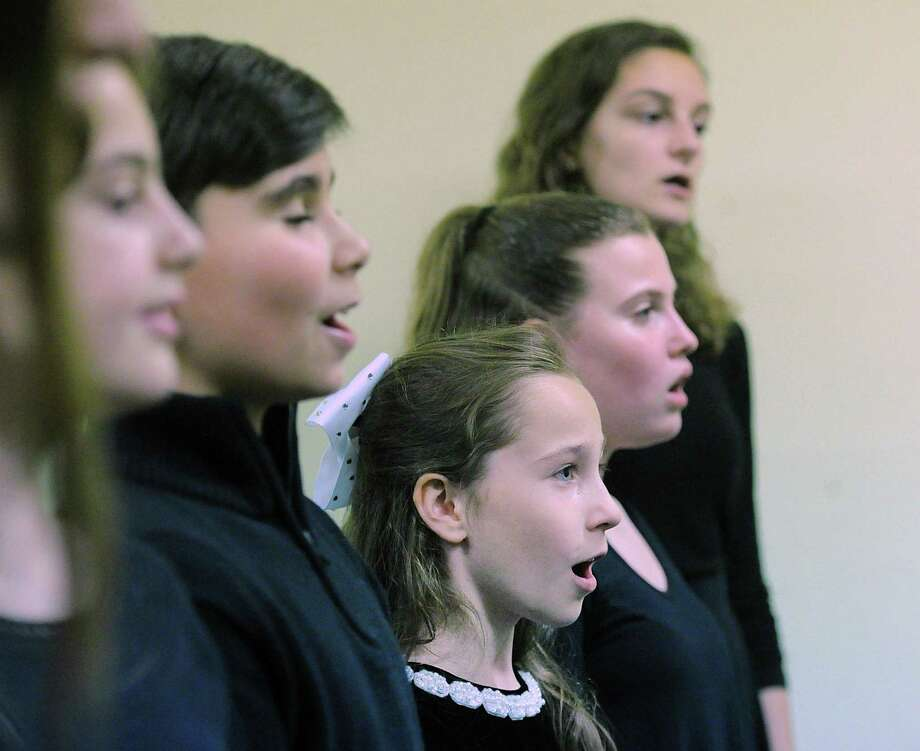 Greenwich Performing Arts Studio singers, including Fiona Reilly, 9, of Stamford, bottom center, rehearse on Wednesday nigh at their Greenwich studio in Cos Cob, for an upcoming November performance at Radio Ciity Music Hall in New York City opening for the Rockettes during their Christmas Spectacular. Photo: Bob Luckey Jr. / Hearst Connecticut Media / Greenwich Time