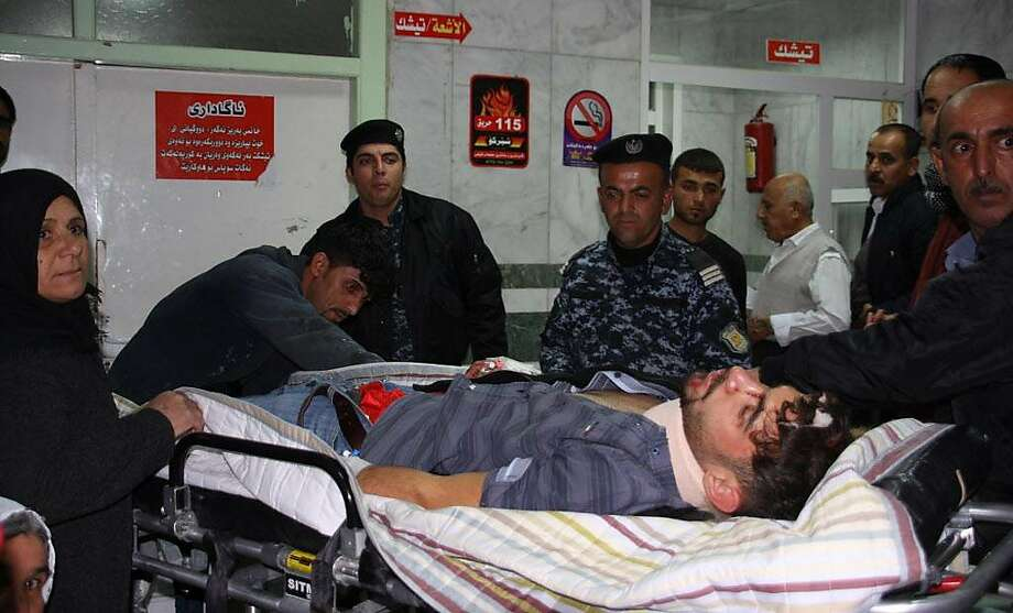 An earthquake victim is aided at Sulaimaniyah Hospital on November 12, 2017, in Sulaimaniyah, Iraq. Officials in Iran reports at least 30 dead and Iraqi officials 6. The US Geological Survey said the magnitude 7.3 temblor was centred 30kms (19 miles) southwest of Halabja, Iraq, near the border with Iran.  / AFP PHOTO / SHWAN MOHAMMEDSHWAN MOHAMMED/AFP/Getty Images Photo: SHWAN MOHAMMED, AFP/Getty Images