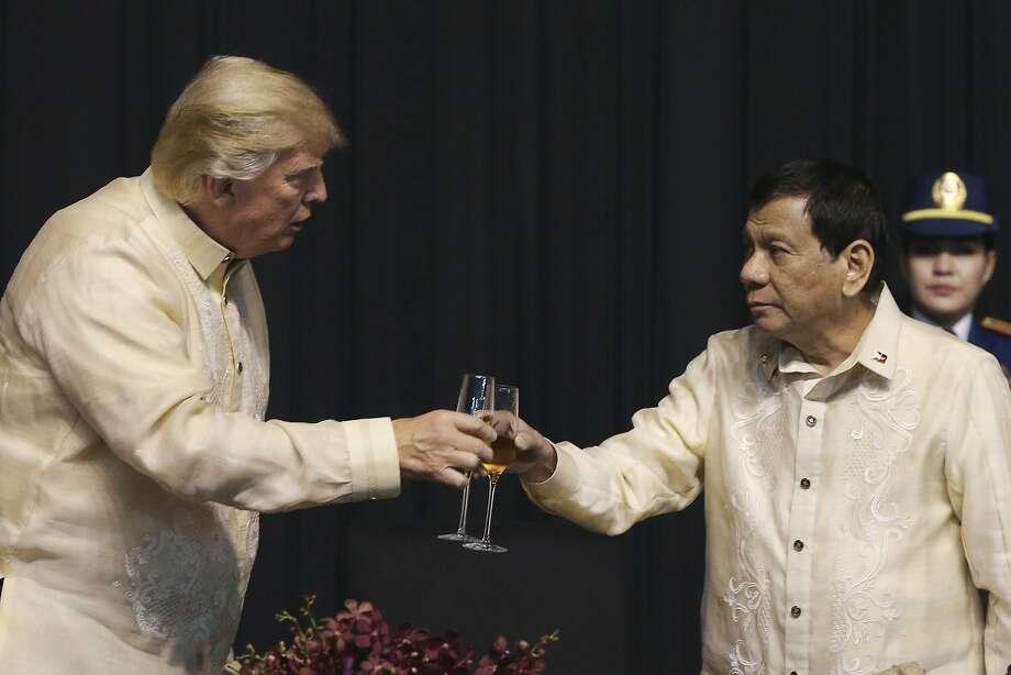 Manila folder: Trump didn't dwell on Philippines President Rodrigo Duterte's mass murder problem. Photo: ATHIT PERAWONGMETHA, Associated Press
