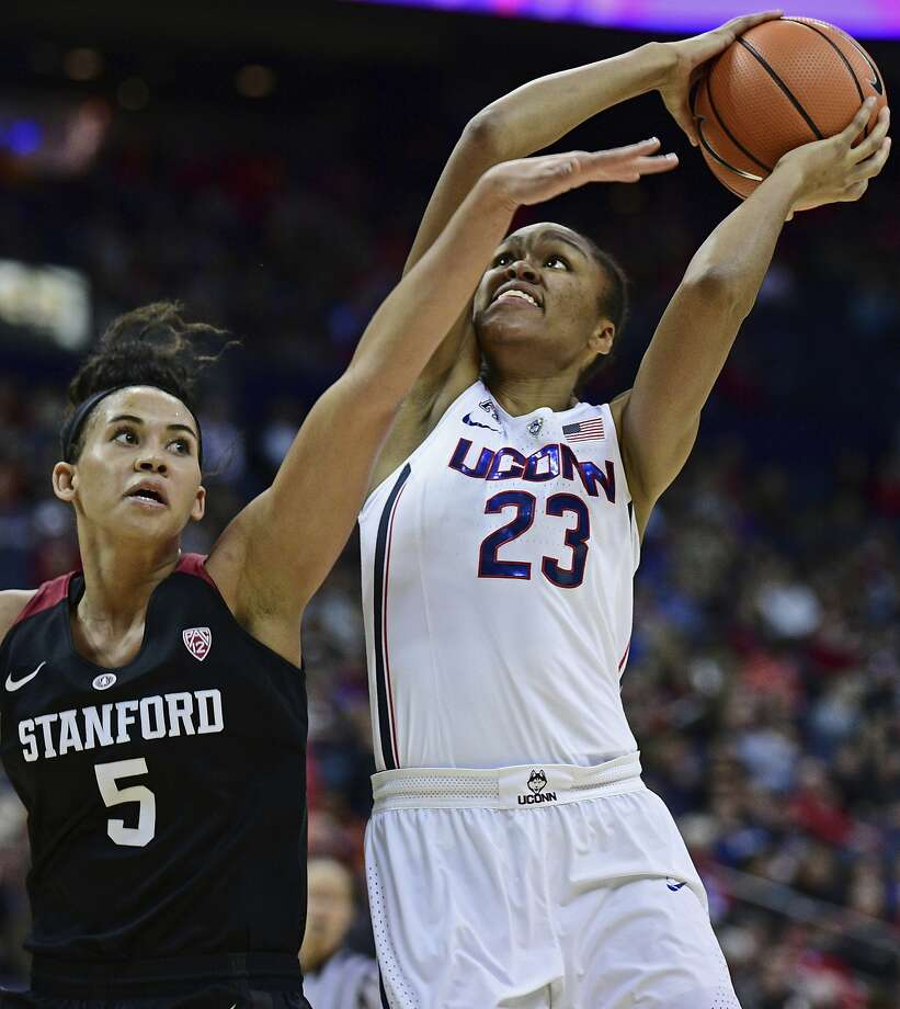 Connecticut's Azura Stevens shoots while being pressured by Stanford's Kaylee Johnson during the fourth quarter of an NCAA college basketball game, Sunday, Nov. 12, 2017, in Columbus, Ohio. Connecticut won 78-53. (AP Photo/David Dermer) Photo: David Dermer, Associated Press