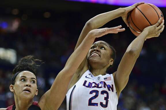 Connecticut's Azura Stevens shoots while being pressured by Stanford's Kaylee Johnson during the fourth quarter of an NCAA college basketball game, Sunday, Nov. 12, 2017, in Columbus, Ohio. Connecticut won 78-53. (AP Photo/David Dermer)