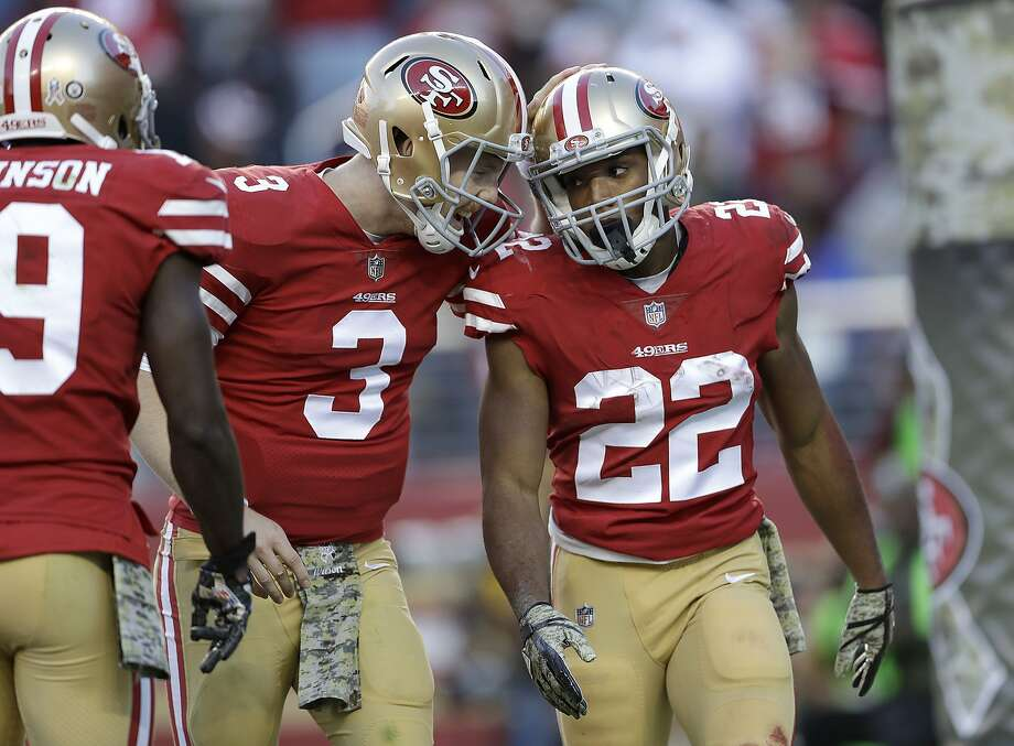 San Francisco 49ers running back Matt Breida (22) is congratulated by quarterback C.J. Beathard (3) after scoring a touchdown against the New York Giants during the second half of an NFL football game in Santa Clara, Calif., Sunday, Nov. 12, 2017. (AP Photo/Marcio Jose Sanchez) Photo: Marcio Jose Sanchez, Associated Press