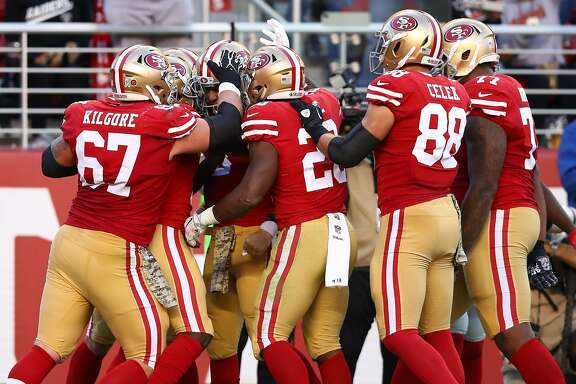 SANTA CLARA, CA - NOVEMBER 12:  C.J. Beathard #3 of the San Francisco 49ers celebrates with teammates after an 11-yard touchdownagainst the New York Giants during their NFL game at Levi's Stadium on November 12, 2017 in Santa Clara, California.  (Photo by Ezra Shaw/Getty Images)