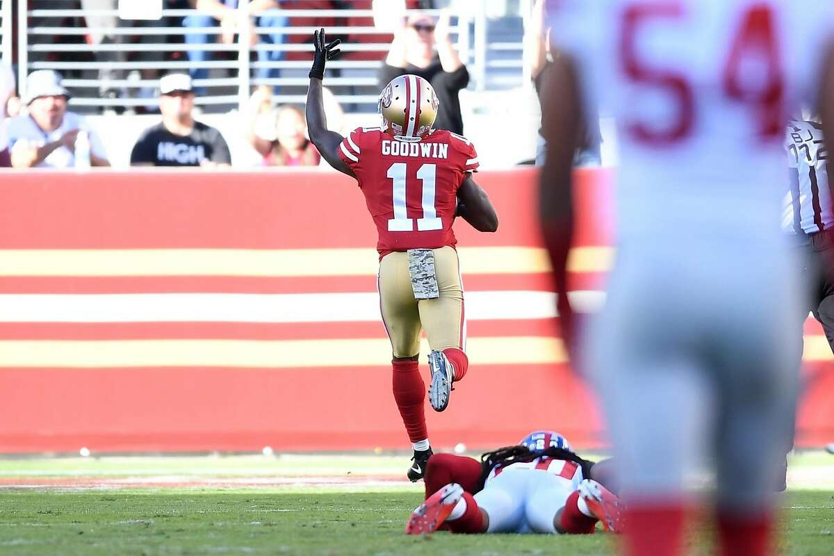 SANTA CLARA, CA - NOVEMBER 12: Marquise Goodwin #11 of the San Francisco 49ers breaks a tackle from Janoris Jenkins #20 of the New York Giants on his way to an 83-yard touchdown against the New York Giants during their NFL game at Levi's Stadium on November 12, 2017 in Santa Clara, California. (Photo by Thearon W. Henderson/Getty Images)