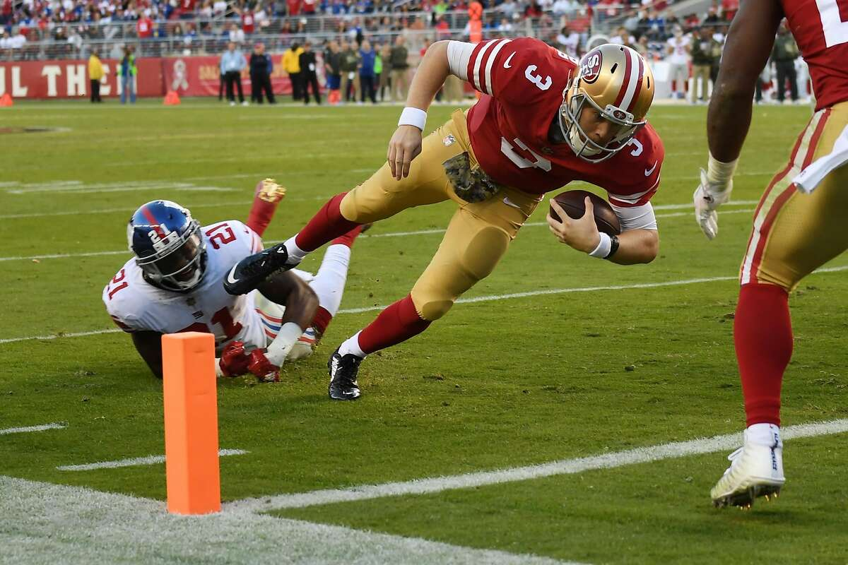 SANTA CLARA, CA - NOVEMBER 12: C.J. Beathard #3 of the San Francisco 49ers dives into the end zone for an 11-yard touchdown against the New York Giants during their NFL game at Levi's Stadium on November 12, 2017 in Santa Clara, California. (Photo by Thearon W. Henderson/Getty Images)