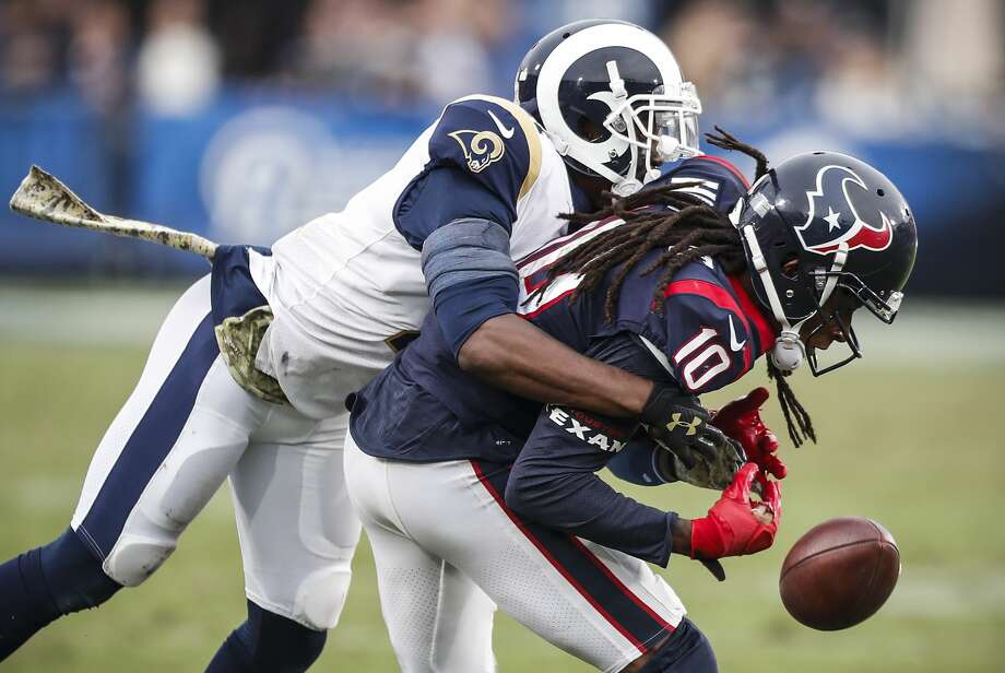 PHOTOS: Aug. 18 preseason - Texans 16, 49ers 13  Los Angeles Rams cornerback Kayvon Webster breaks up a pass intended for Houston Texans wide receiver DeAndre Hopkins (10) during the fourth quarter of an NFL football game at the Los Angeles Memorial Coliseum on Sunday, Nov. 12, 2017, in Los Angeles, Mass. ( Brett Coomer / Houston Chronicle ) >>>See Texans in action during their preseason win over the 49ers on Saturday, Aug. 18, 2018 ...  Photo: Brett Coomer/Houston Chronicle