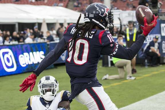 Houston Texans wide receiver DeAndre Hopkins (10) is knocked out of bounds by Los Angeles Rams cornerback Kayvon Webster (21) for an incomplete pass during the fourth quarter of an NFL football game at the Los Angeles Memorial Coliseum on Sunday, Nov. 12, 2017, in Los Angeles, Mass. ( Brett Coomer / Houston Chronicle )