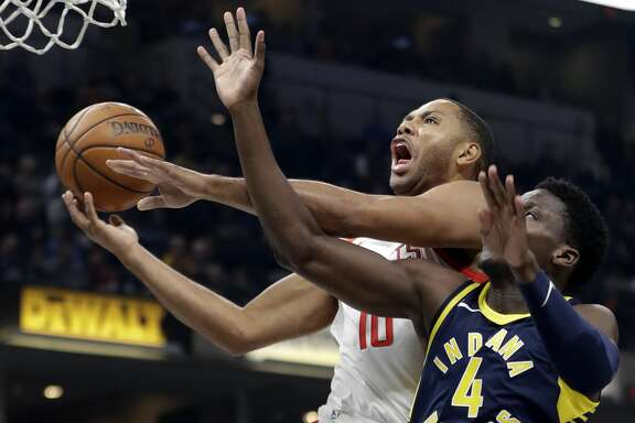 Houston Rockets' Eric Gordon (10) shoots against Indiana Pacers' Victor Oladipo (4) during the first half of an NBA basketball game, Sunday, Nov. 12, 2017, in Indianapolis. (AP Photo/Darron Cummings)